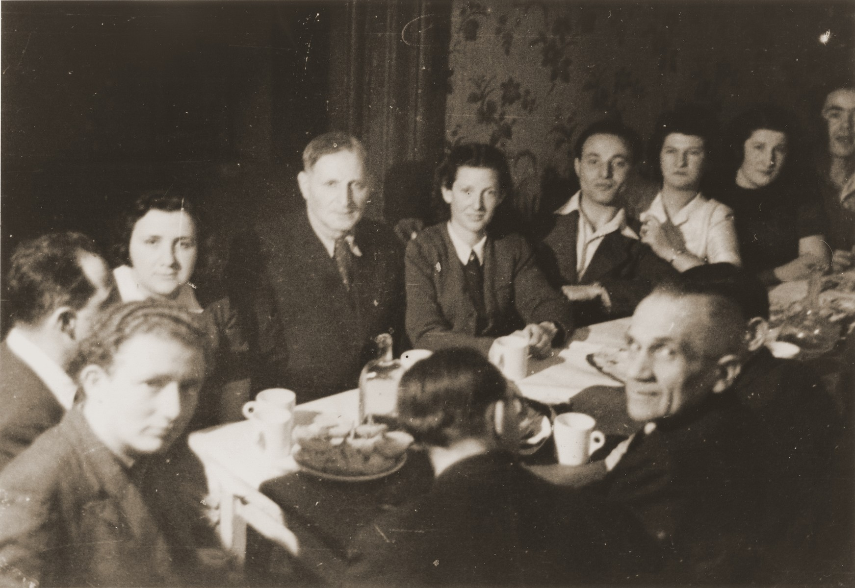 A party at Bricha headquarters in Vienna on Frankgasse 2.  Those pictured include Shmulik Matzner who later fell in Israel's War of Independence, Hermine, Abel Birman and Margot Feuer.