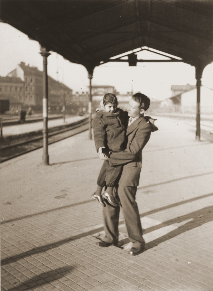 Shmulik Matzner, holding a child, waits at the Vienna railroad station for a train to take him on the next leg of his journey along the Bricha route to the American Zone of Germany.