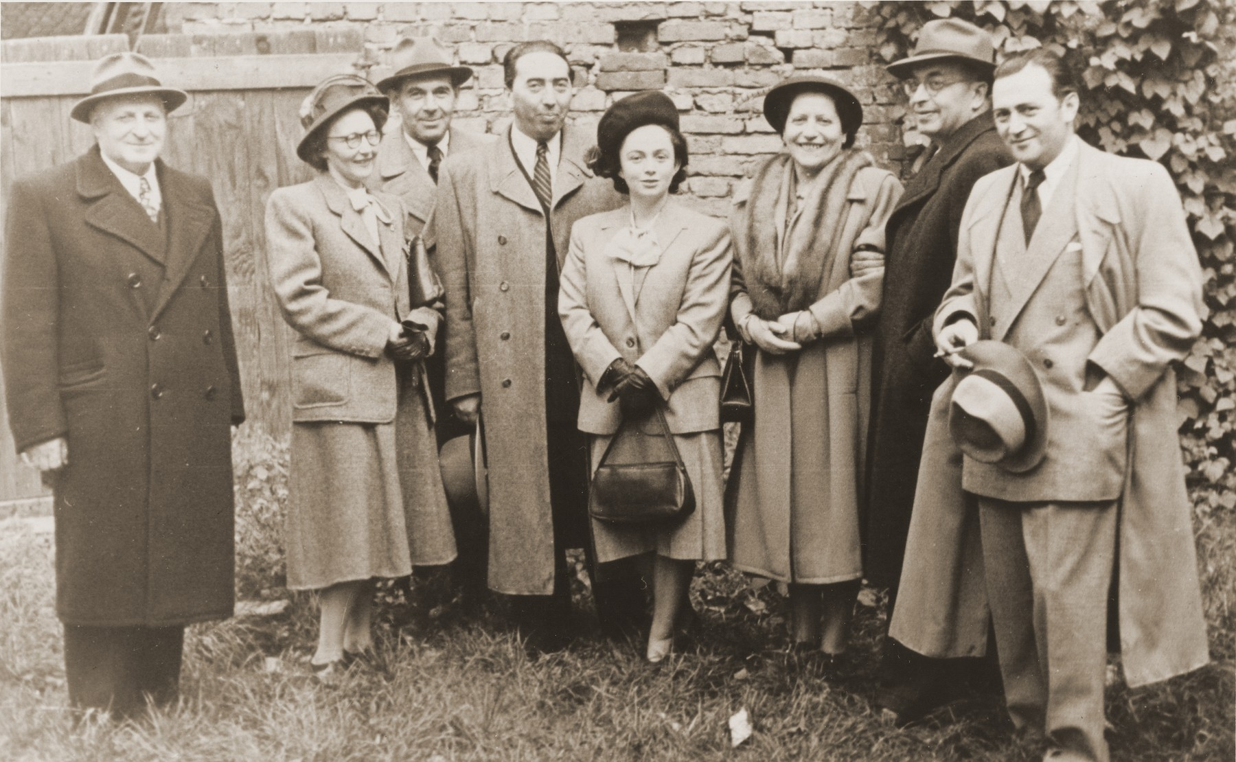 Members of the staff of the Rothschild Hospital pose on the hospital's grounds.  From left to right are Abel Birman, Mrs. and Mr. Winkler, Dr. and Mrs. Jonas and Bella (also known as Beyle Schaechter-Gottesman) Gottesman and the head nurse.