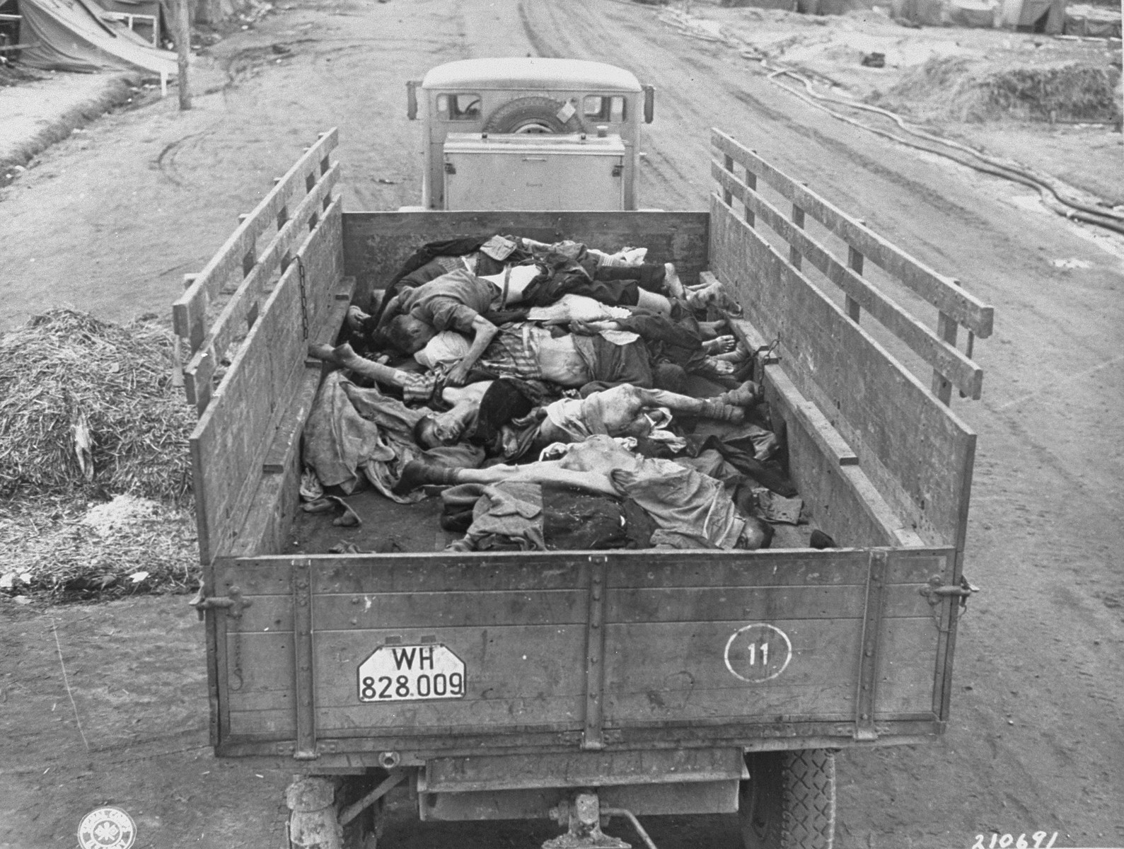 A British Army truck transporting corpses to mass graves for burial.