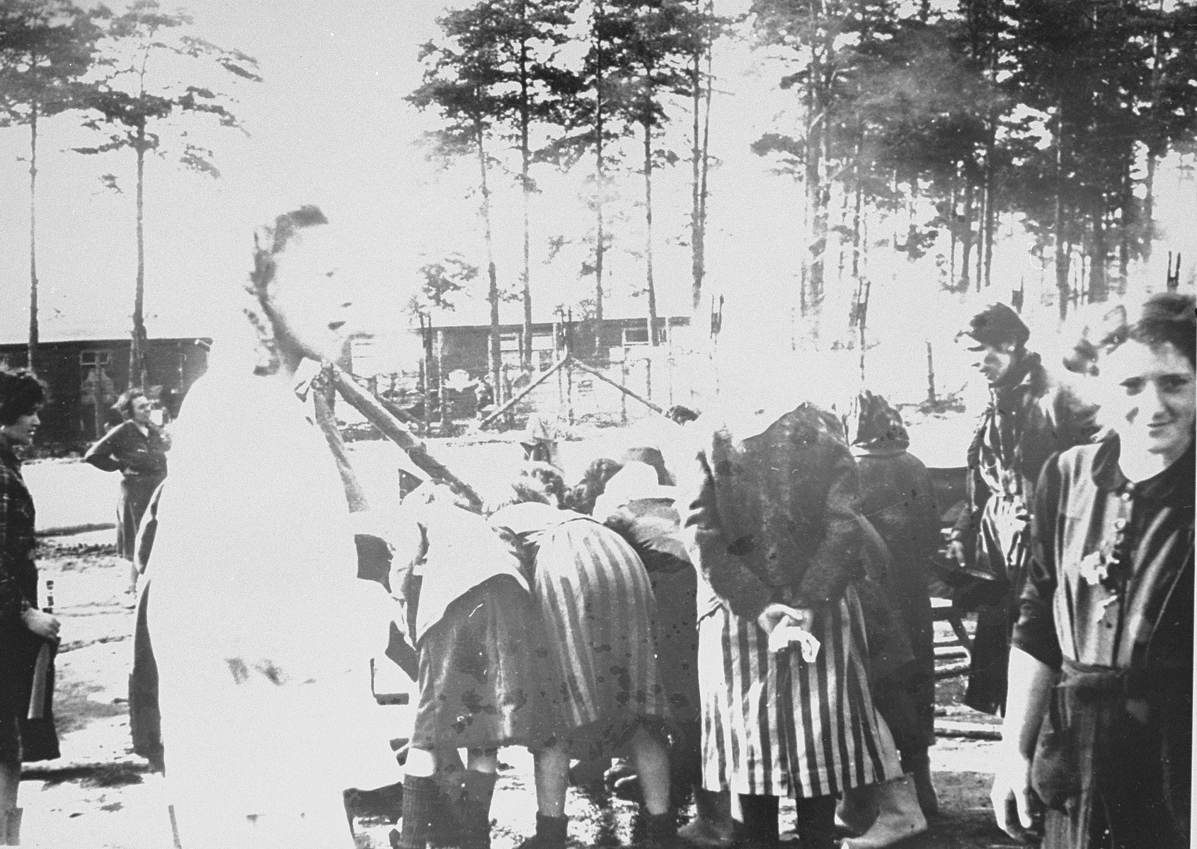 Female survivors in Bergen-Belsen use fresh water pumped into the camp by the British Army.