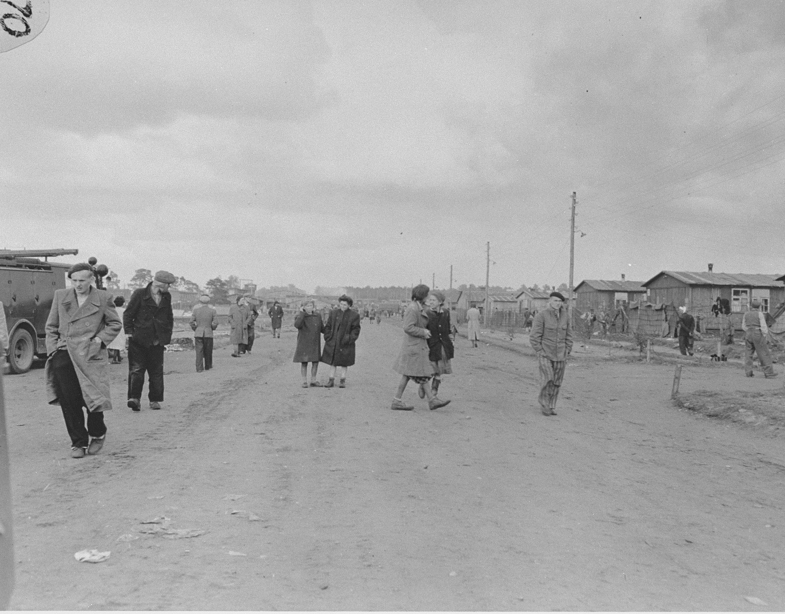 Survivors on a street in Bergen-Belsen.