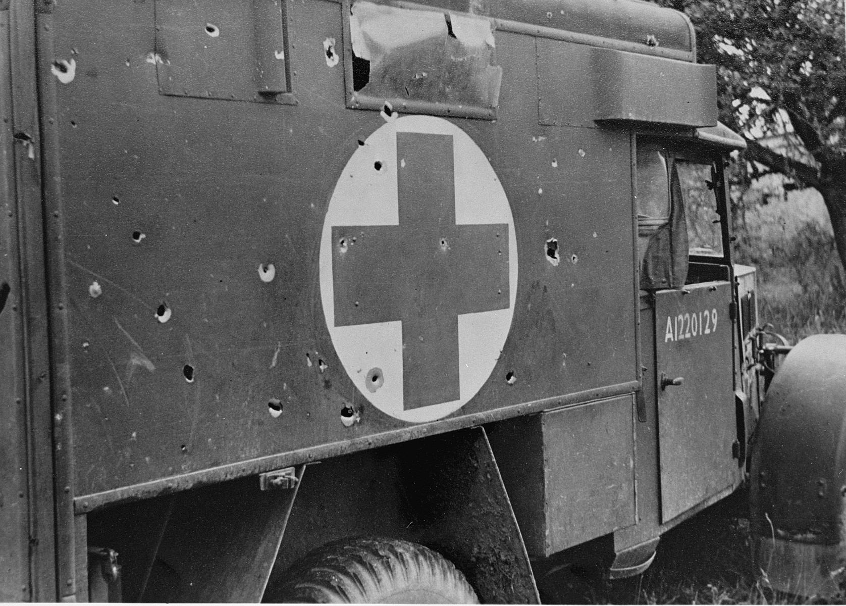 View of a British military ambulance with gun-fire damage.