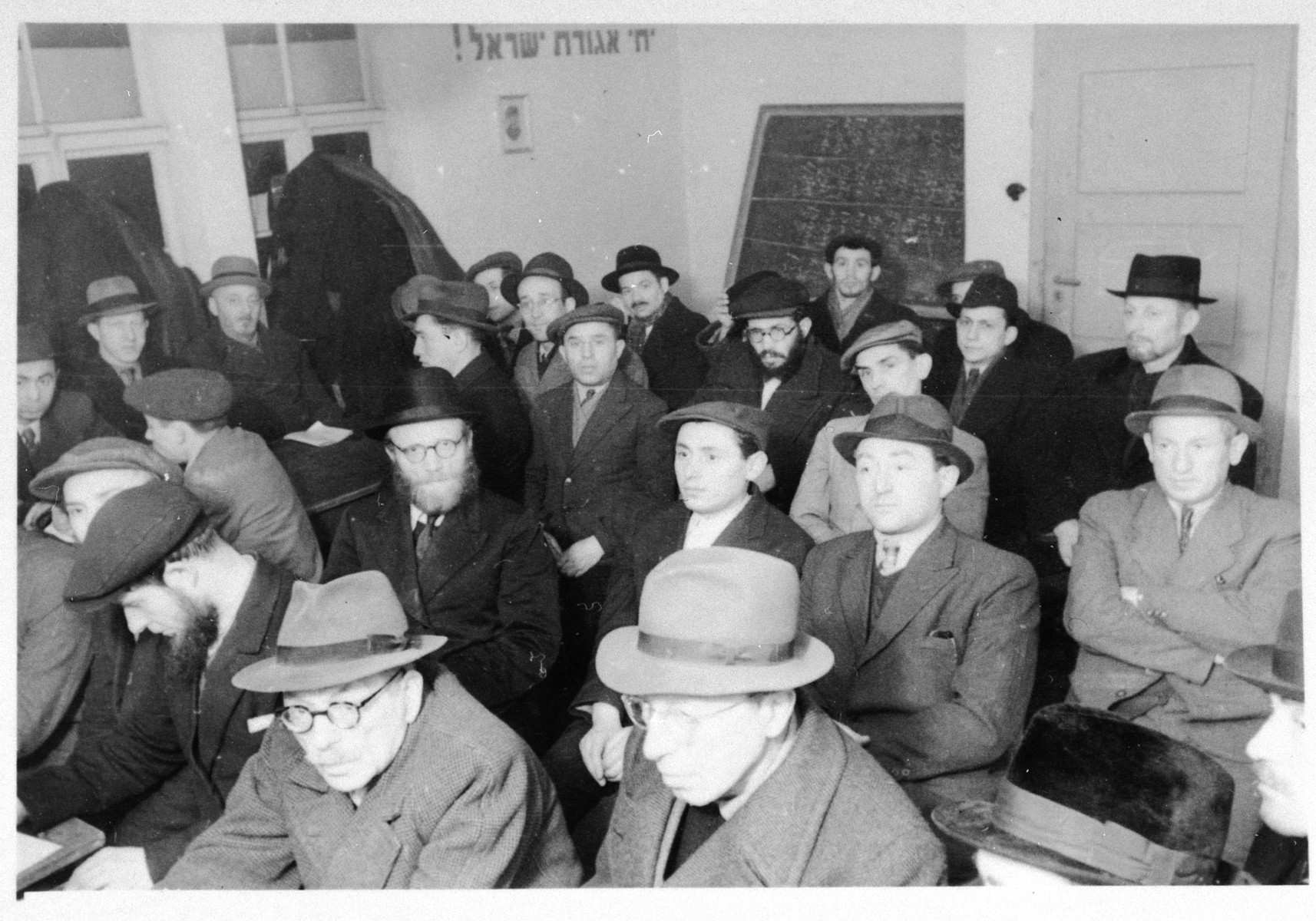 Religious Jews gather for a meeting of the Agudat Yisrael in the Zeilsheim displaced persons' camp.