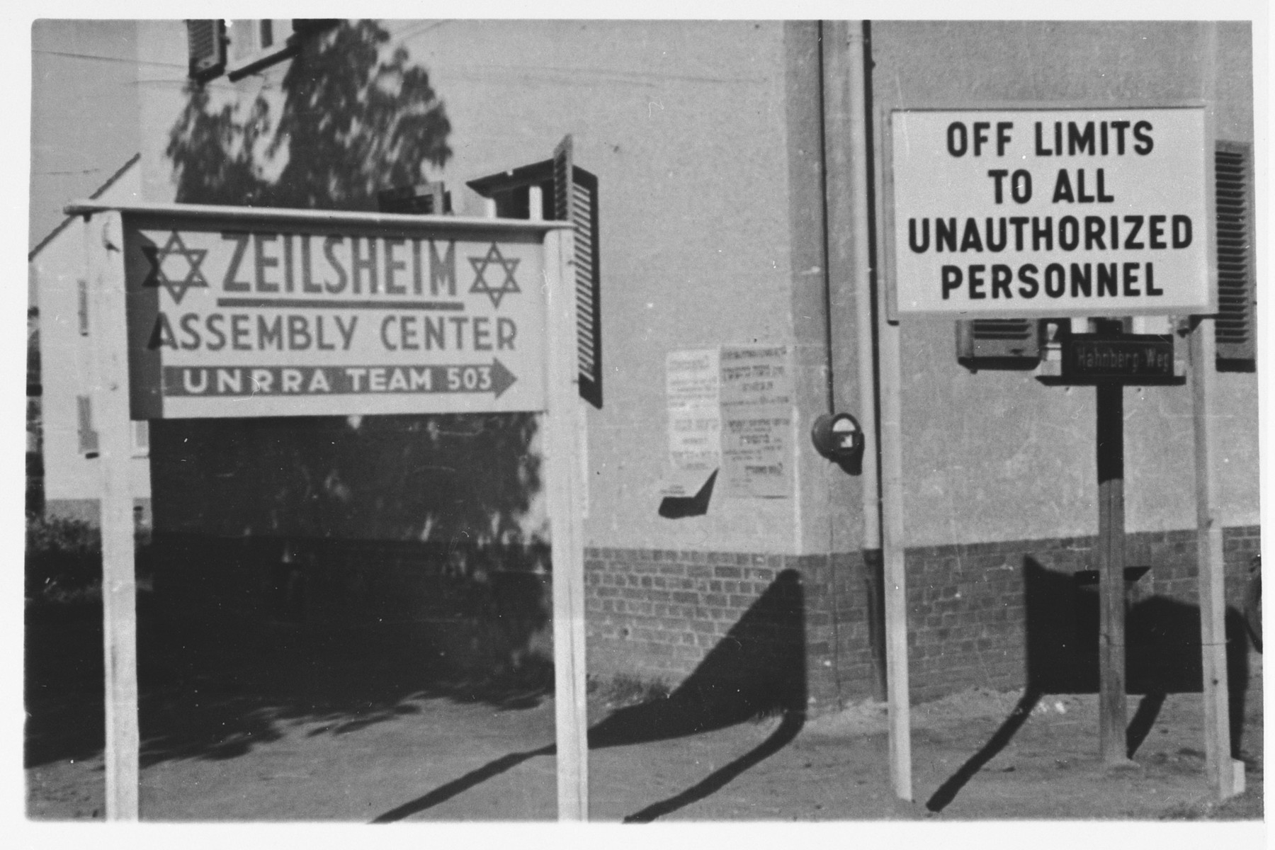 View of the signs marking the entrance to the Zeilsheim displaced persons' camp.