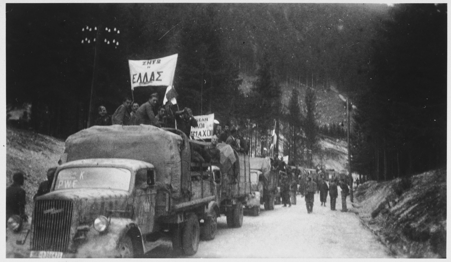 A convoy of Greek prisoners departs Ebensee for their repatriation.
