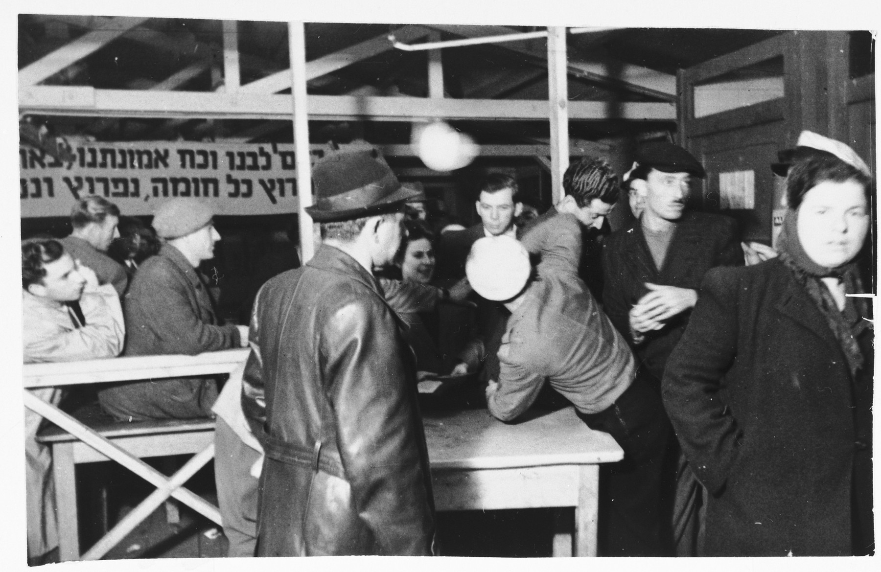 A Jewish policeman supervises elections in the Zeilsheim displaced persons' camp.