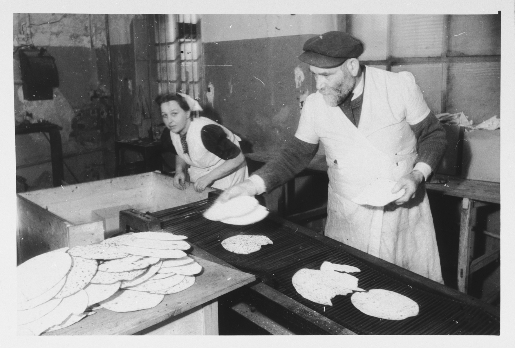 Two bakers prepare Passover matzah in the Zeilsheim displaced persons' camp.