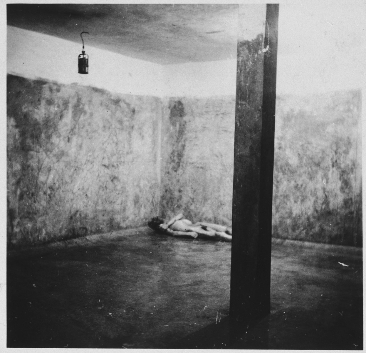 View of a corpse lying on the floor of a crematoria.