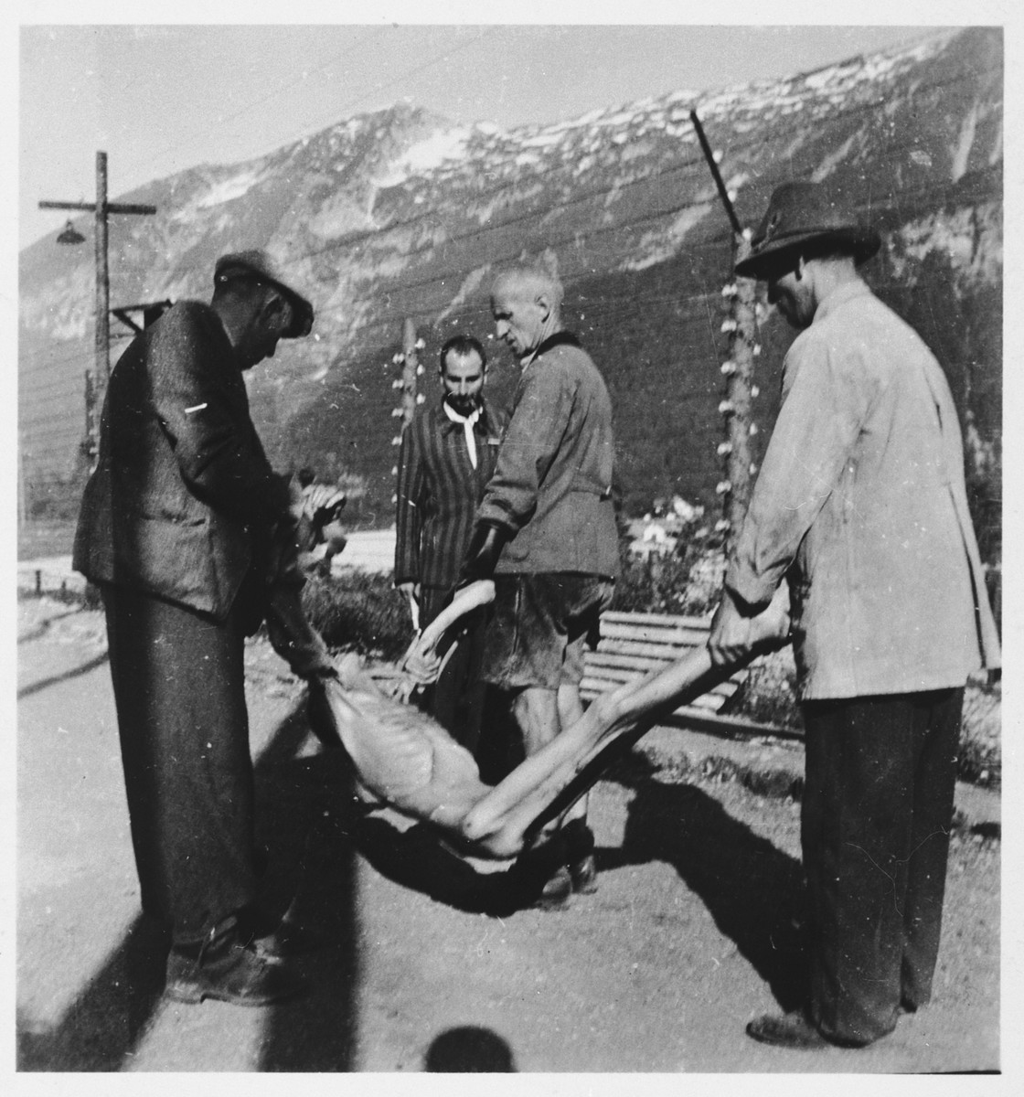Austrian civilians remove corpses for burial after the liberation of the Ebensee concentration camp.