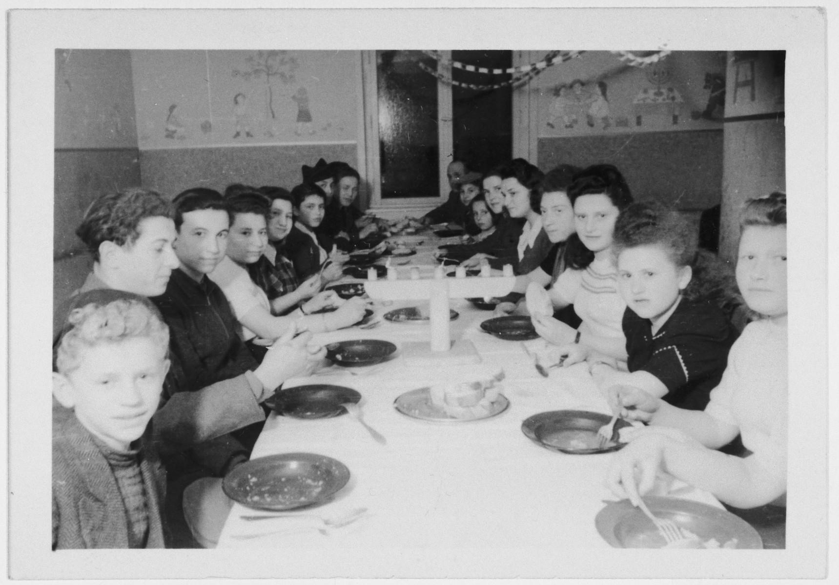 Children celebrate Hannukah in the Zeilsheim DP camp.  Szlomo Waks is pictured in the bottom left corner.