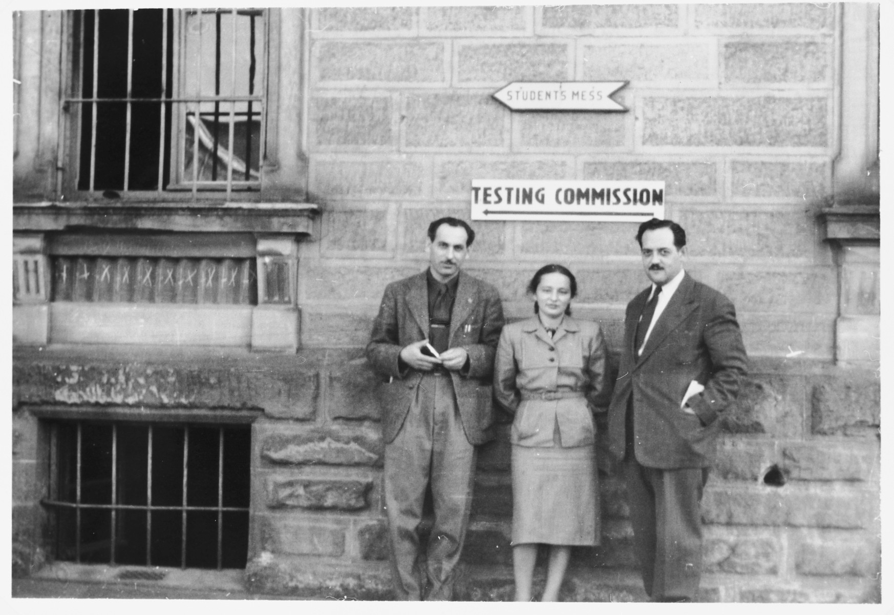 Canadian delegates stand outside the testing commission where prospective immigrants into Canada will be trade tested.  From left to right are David Siegel, the liaison between Canadian immigration and the Canadian Jewish Congress, Bella Meiskin of the Jewish Labor Committee and Lucien St. Cyr from the Canadian Labor Department.