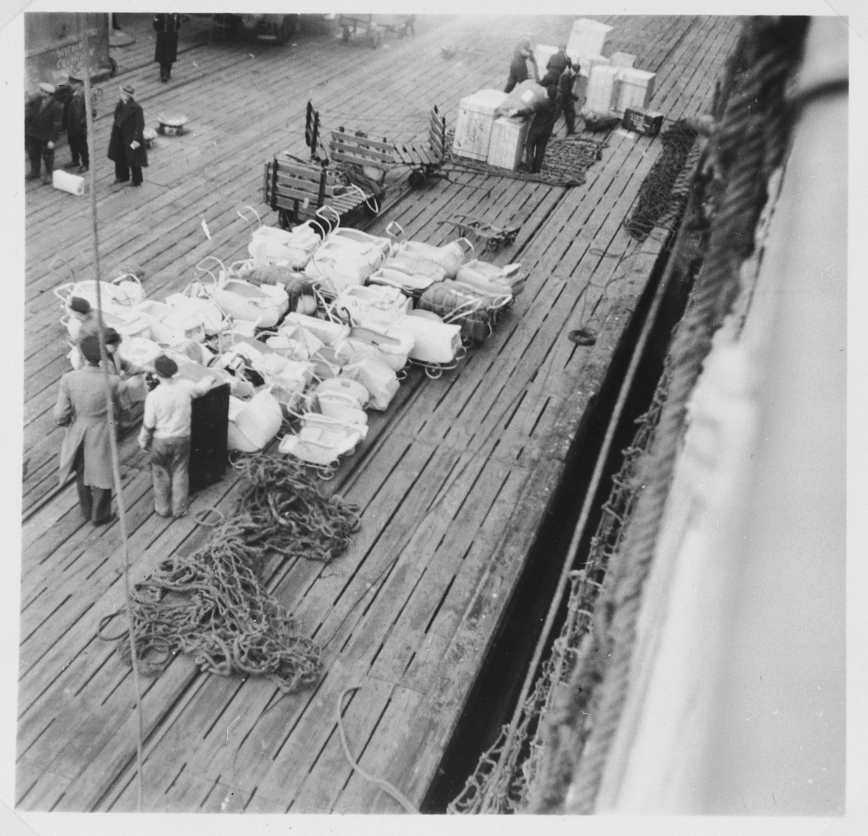 Baby carriages line the dock prior to their being loaded on board the Cunard Liner which will carry Jewish displaced persons to Canada.
