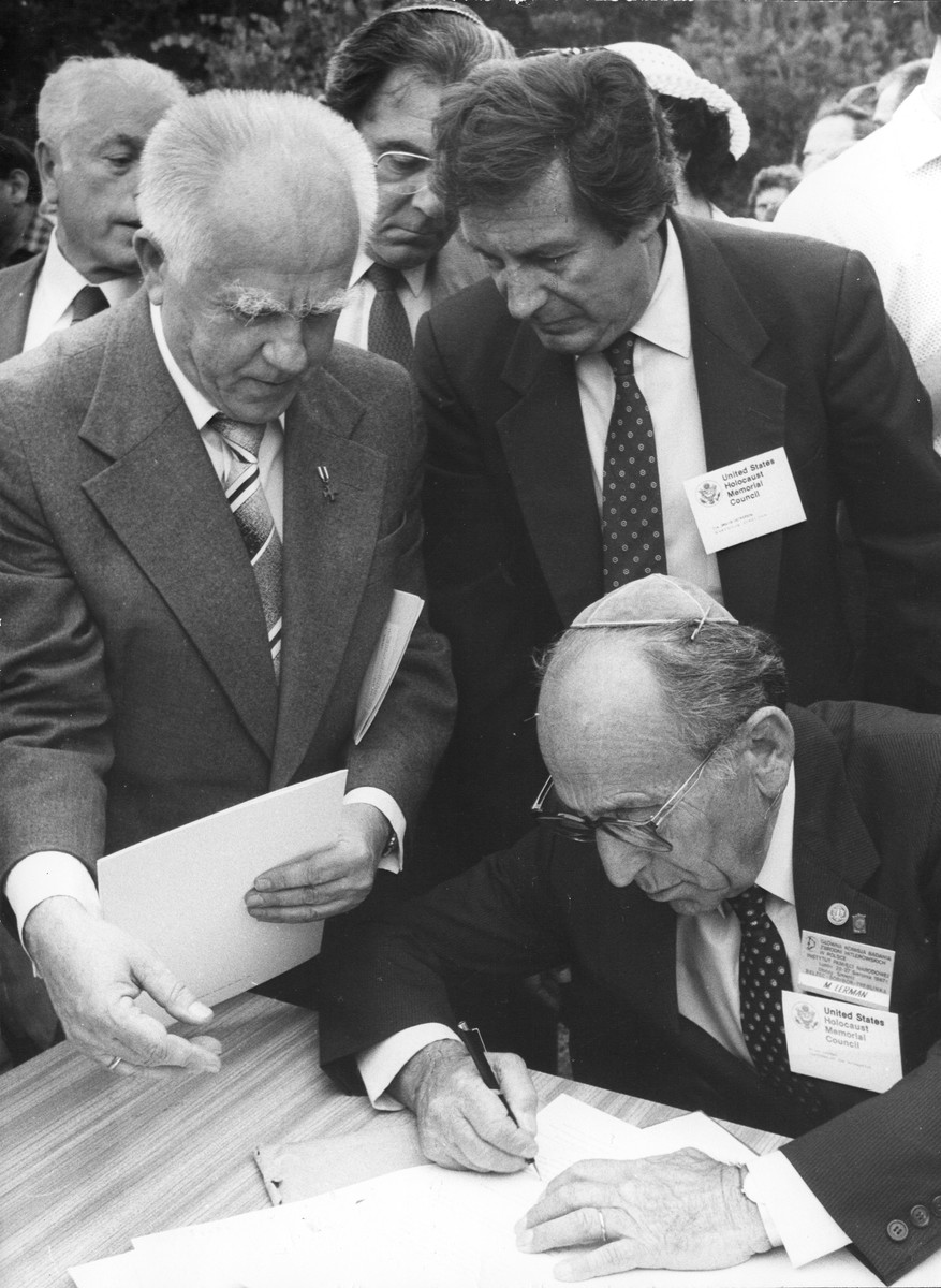Miles Lerman, representing the U.S, Holocaust Memorial Council, signs an agreement with the Main Commission for the Investigation of Nazi Crimes in Poland at the site of Belzec.