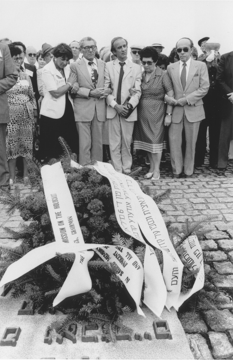 Survivors attend a wreath-laying ceremony at the memorial to the dead in Birkenau during the U.S. Holocaust Commission fact-finding trip to Europe in the summer of 1979.  Among those pictured are Elie Wiesel (center) and Hadassah Rosensaft (third from the right).