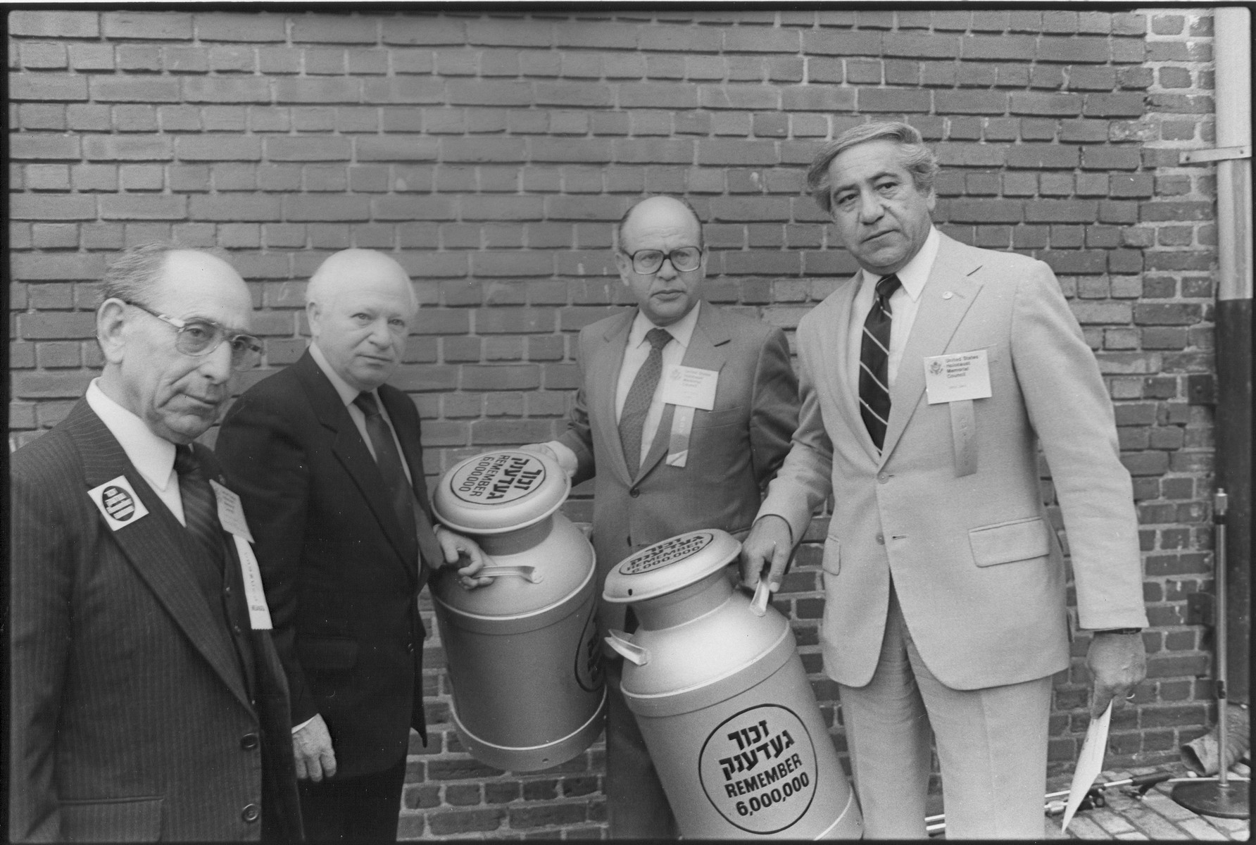 Members of the United States Holocaust Memorial Council pose with two milkcans containing a Scroll of Remembrance signed by Holocaust survivors at the Symbolic Groundbreaking Ceremony of the U.S. Holocaust Memorial Museum.  Pictured from left to right are: Miles Lerman, Benjamin Meed, Samuel E. Bloch and David Chase.