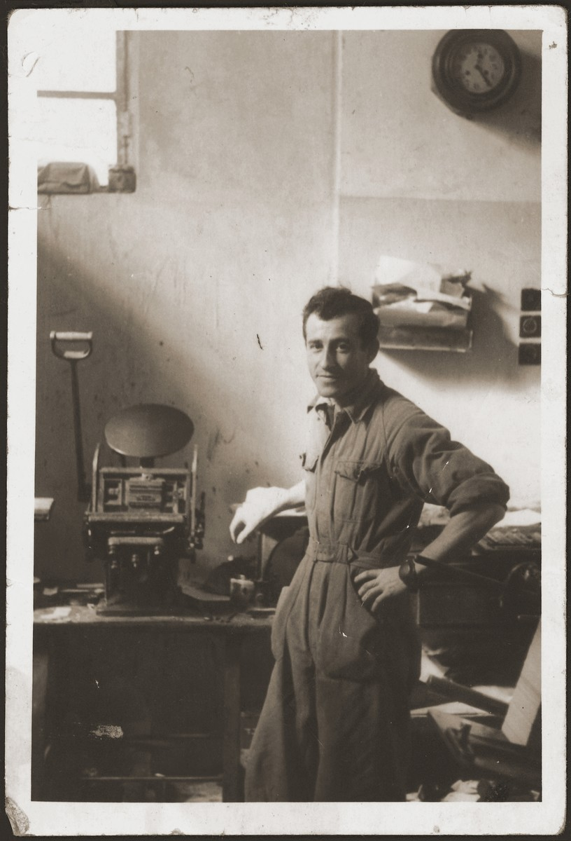 Bernard Moncznik poses in the print shop in which he was employed in Krynica.
