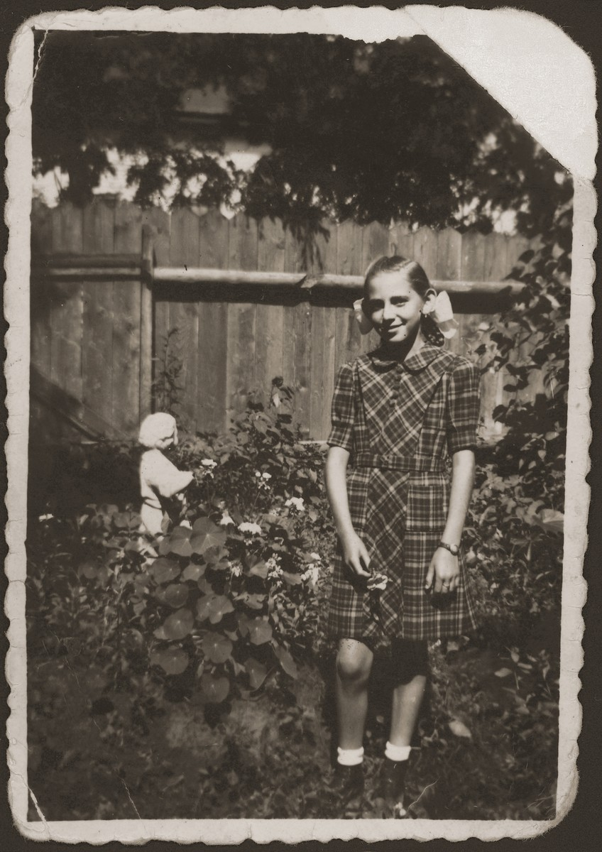 Portrait of Vera Salamon as a young girl in the garden of her home in Valea-lui-Mihai, Romania.