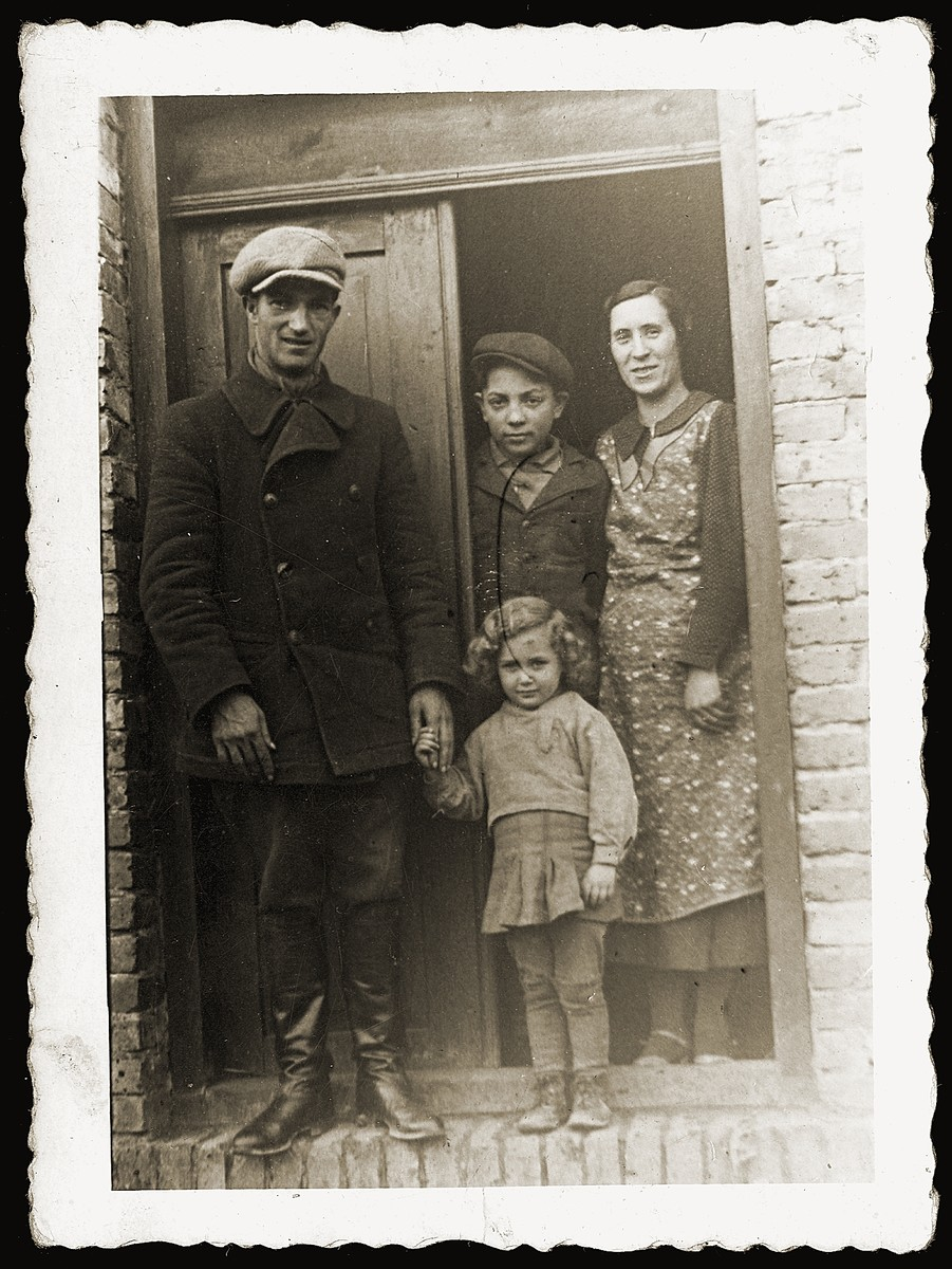 Zendel Lancman, his wife and children stand in the doorway of their home.