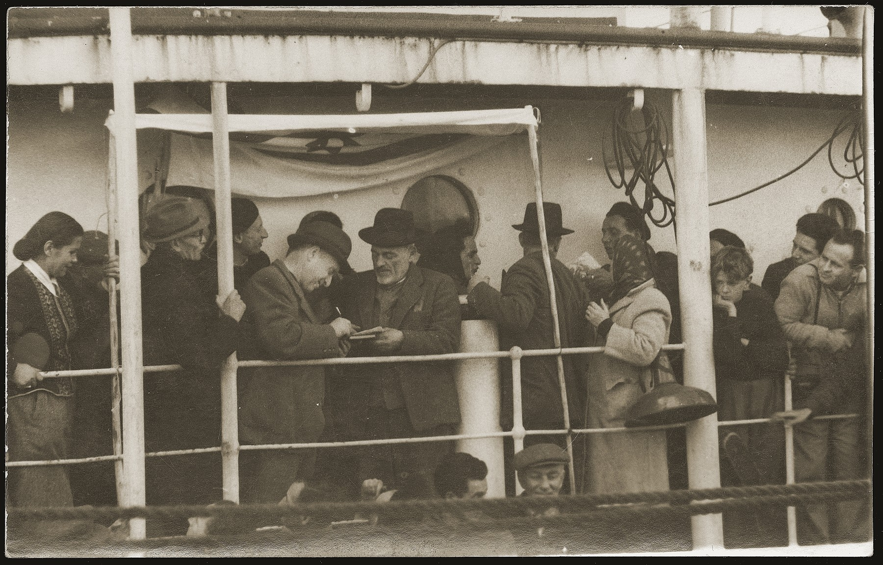 A witness signs the ketubah [marriage contract] at the marriage ceremony of a Yugoslavian-Jewish couple on board the SS Kefalos, sailing from Bakar to Israel.
