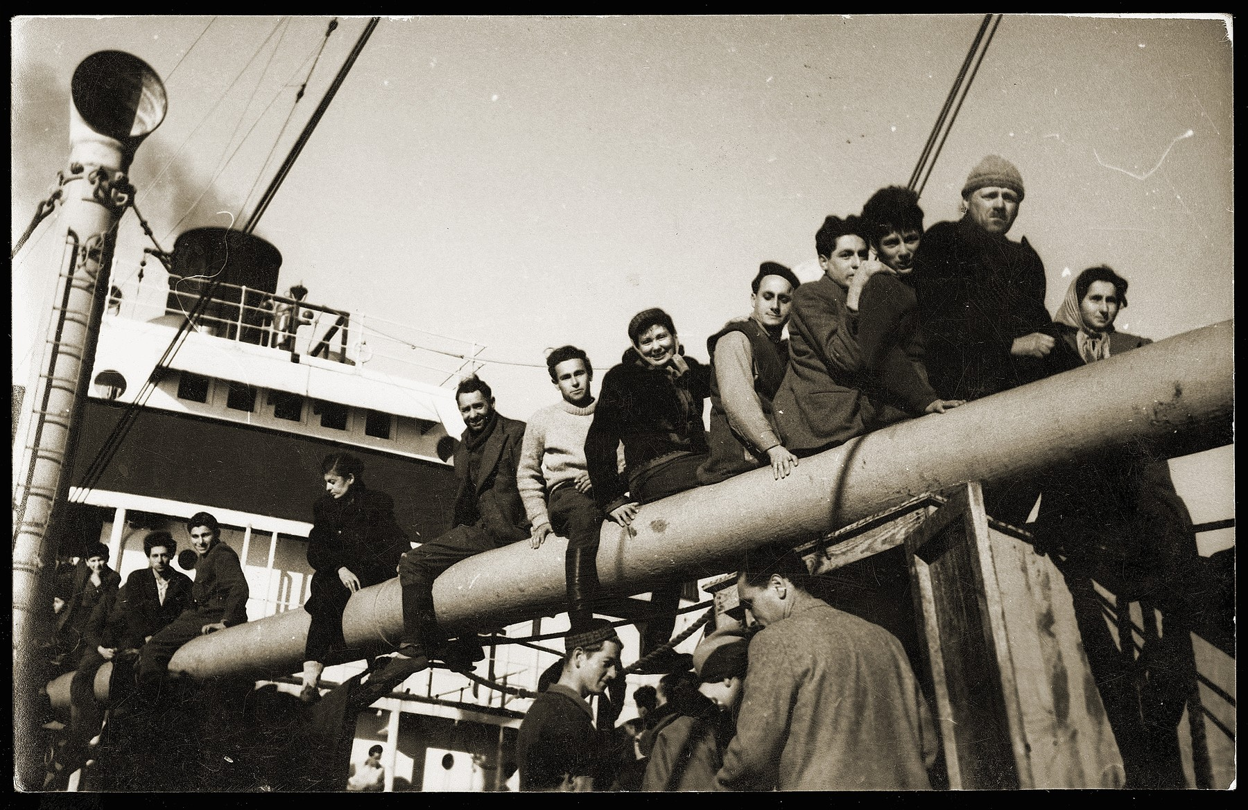 Yugoslavian Jews on the deck of the SS Kefalos, sailing from Bakar to Israel.  Among those pictured is Gyorgy Laszlo (bottom center, wearing a cap).  He was born in Subotica in 1929 and grew up in Becej, Yugoslavia. His mother, uncle, aunt, and two cousins also sailed on the same ship.