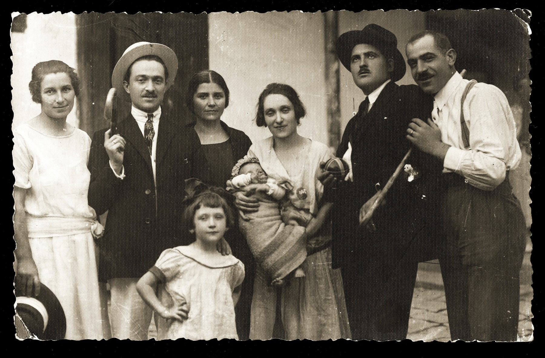 Group portrait of the Konfino family in Belgrade.    Among those pictured are Gavra (far right), Gabriela (Ela, the child in front), and Gizela (the infant).