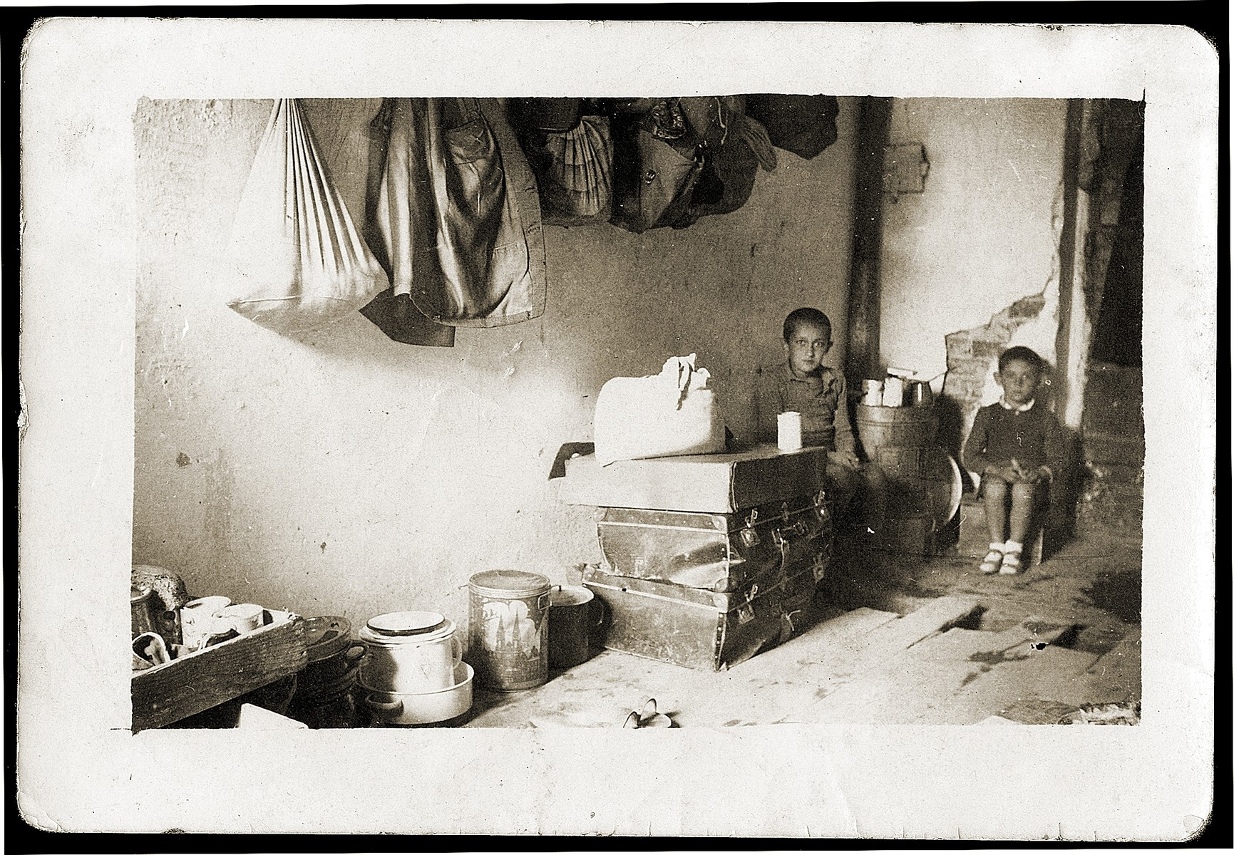 Two Jewish refugee children in their cell in the Pristina prison, where they were detained with their families by the Italians for eight months.  Pictured are Gavra Mandil (right) and Michael Konforti (left).