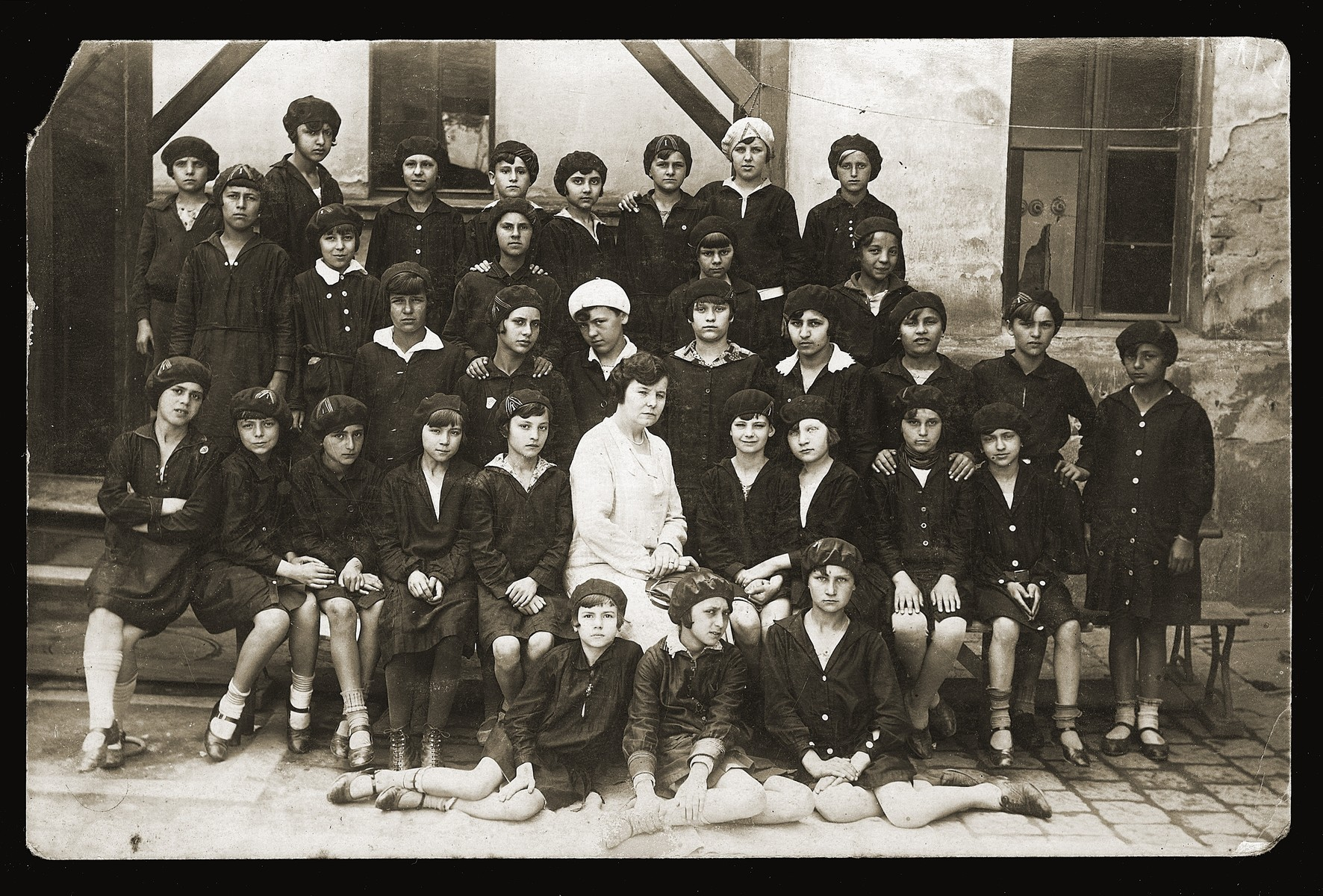 Group portrait of Gabriela Konfino's fifth grade class in a Jewish school in Belgrade.  Gabriela Konfino is pictured in the second row, third from the right.