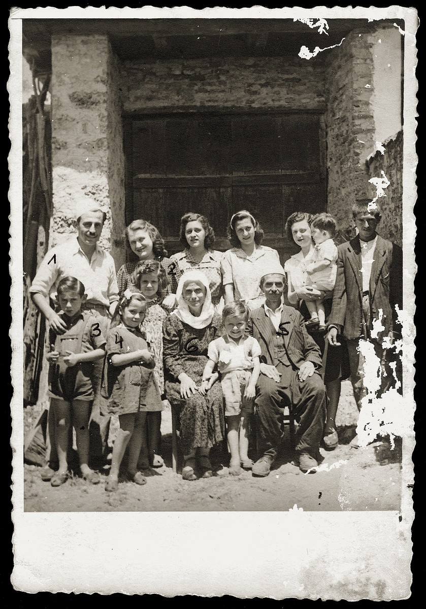 Group portrait of a Yugoslavian Jewish family and the Albanians who sheltered them.    Pictured in the front row (left to right) are Gavra and Irena Mandil, Fatima and Vesel Veseli.  Standing behind (left to right) are Mosa (Moshe) and Gabriela (Ela) Mandil.