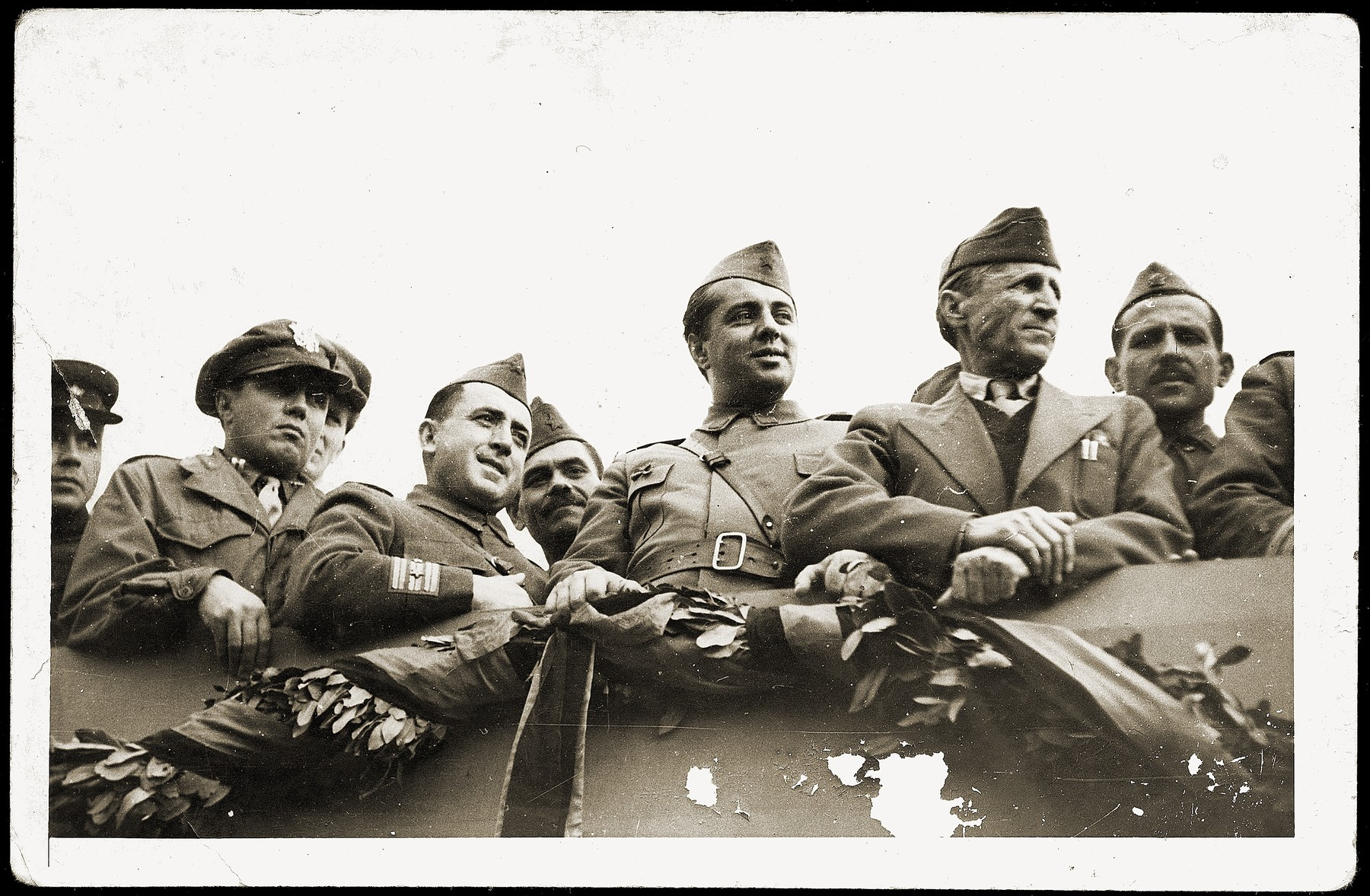 Albanian communist leader, Enver Hoxha (center), reviews the troops at a military parade marking the liberation of Tirana.