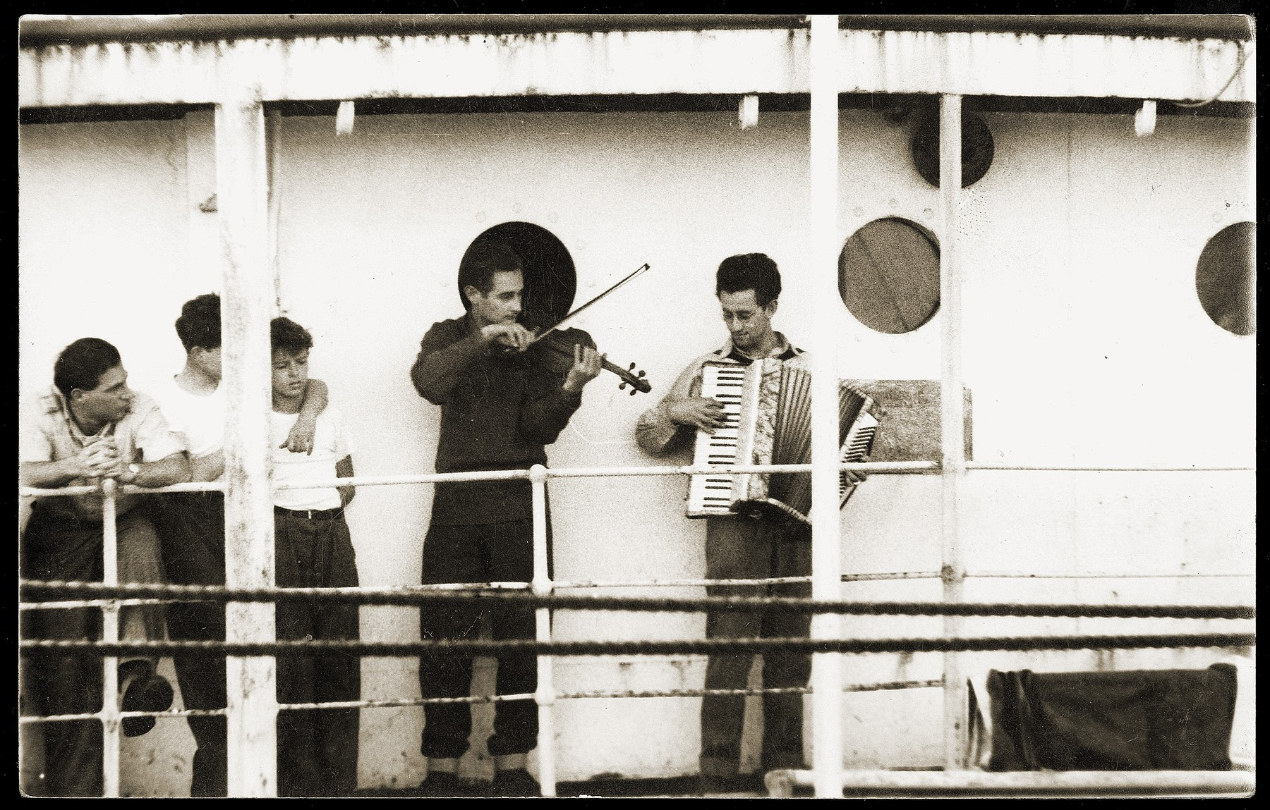 Two musicians perform on the deck of the SS Kefalos, sailing from Bakar to Israel.