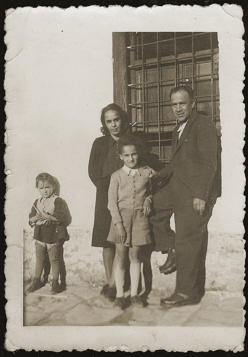 Jewish refugees pose outside the Pristina prison.    Pictured from left to right are: Irena Mandil, Mimi Altarac, Jasa Altarac and Majer Altarac.