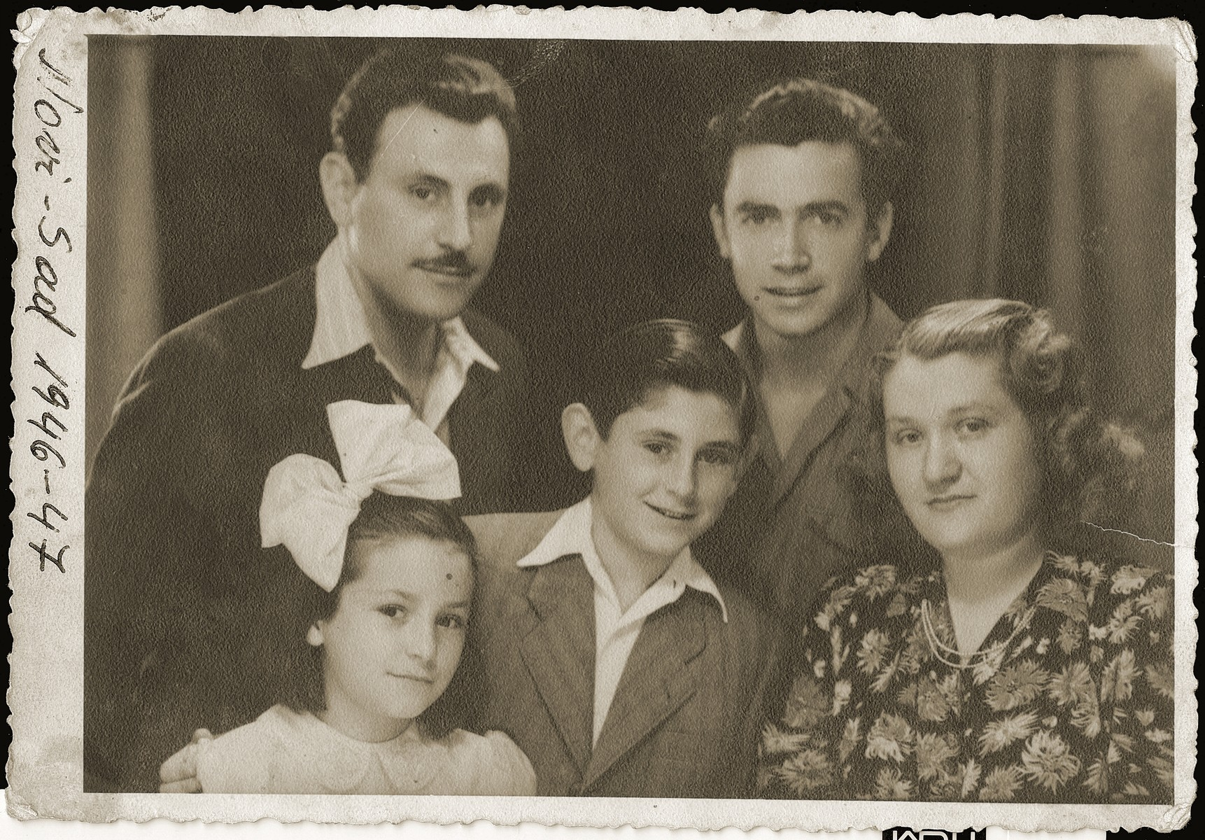 The Mandil family with their Albanian rescuer, Refik Veseli.  In 1990 Refik Veseli was recognized by Yad Vashem as one of the Righteous Among the Nations.  Pictured in the front row (from left to right) are: Irena, Gavra and Gabriela (Ela) Mandil.  In the back row (from left to right) are: Mosa (Moshe) Mandil and Refik Veseli.