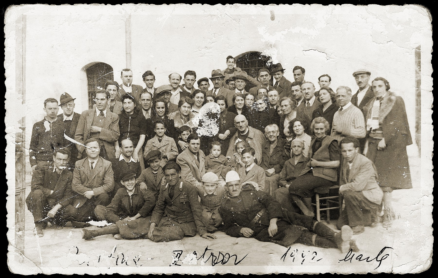 Group portrait of Jewish families, who were imprisoned with the Mandils in Italian-occupied Pristina.