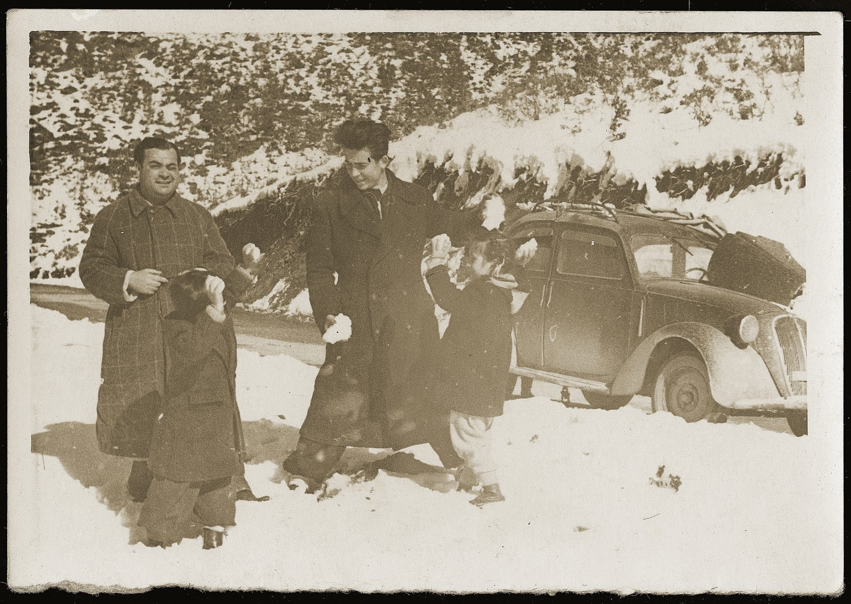 Refik Veseli (right) plays with Irena and Gavra Mandil in the snow during the period in which he hid them at his parents' home in Kruja.  The four are on their way to the wedding of Neshed Ismail in the Kosovo Mountains.