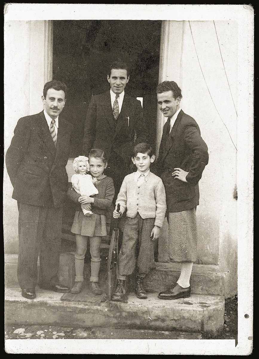 Group portrait of members of the Mandil family with an Albanian photographer.  Pictured clockwise from the left are: Mosa Mandil, Neshed Ismail, Vefa ?, Gavra Mandil and Irena Mandil.