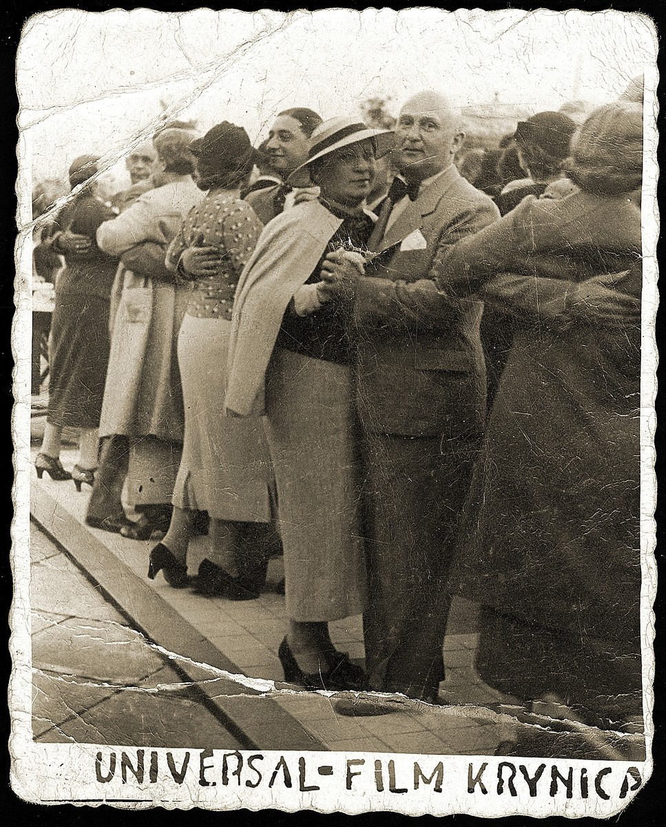 Couples dance outside on a crowded dance floor in the resort town of Krynica.  Among those pictured are Mania (Tropauer) Pinkus and her husband (facing the camera).  Mania Pinkus was was the aunt of David Klajman (the donor).  She and her husband both perished in Auschwitz.