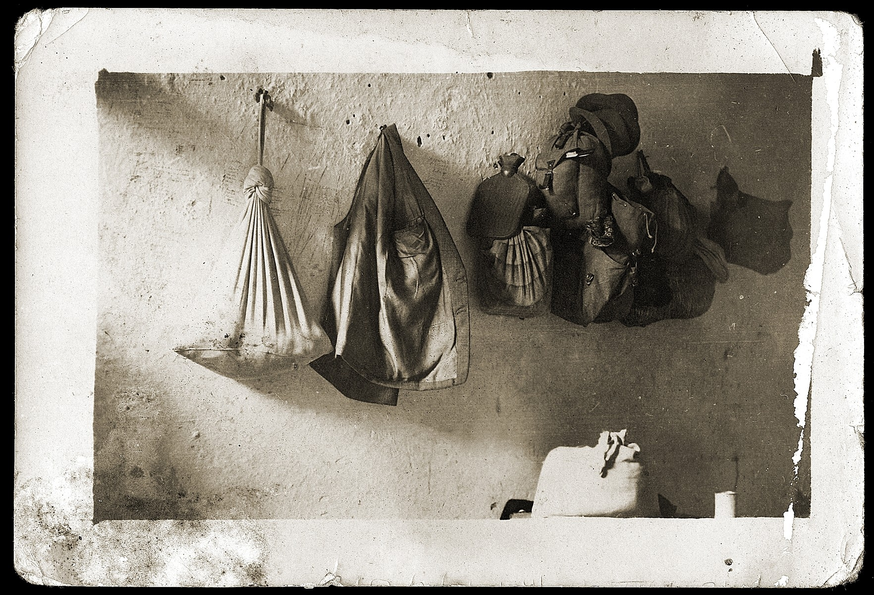 A few belongings of the Mandil family hang on hooks in the prison cell where they were detained for eight months by the Italians.