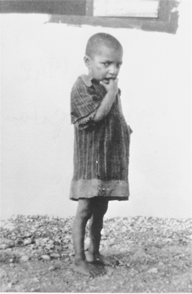 """A Romani (Gypsy) child interned in the Rivesaltes transit camp.  The original caption reads, """"a Gypsy child who loves to dance on tables."""""""