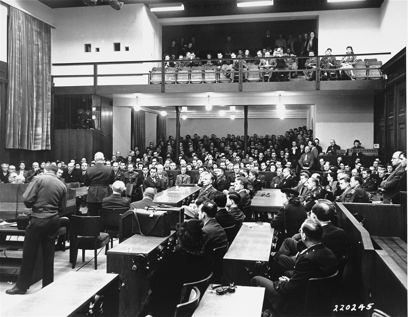 Captain Henry Gereke, a U.S. Army chaplain, reads a short sermon to the audience during a Thanksgiving Day service at the International Military Tribunal trial of war criminals at Nuremberg.