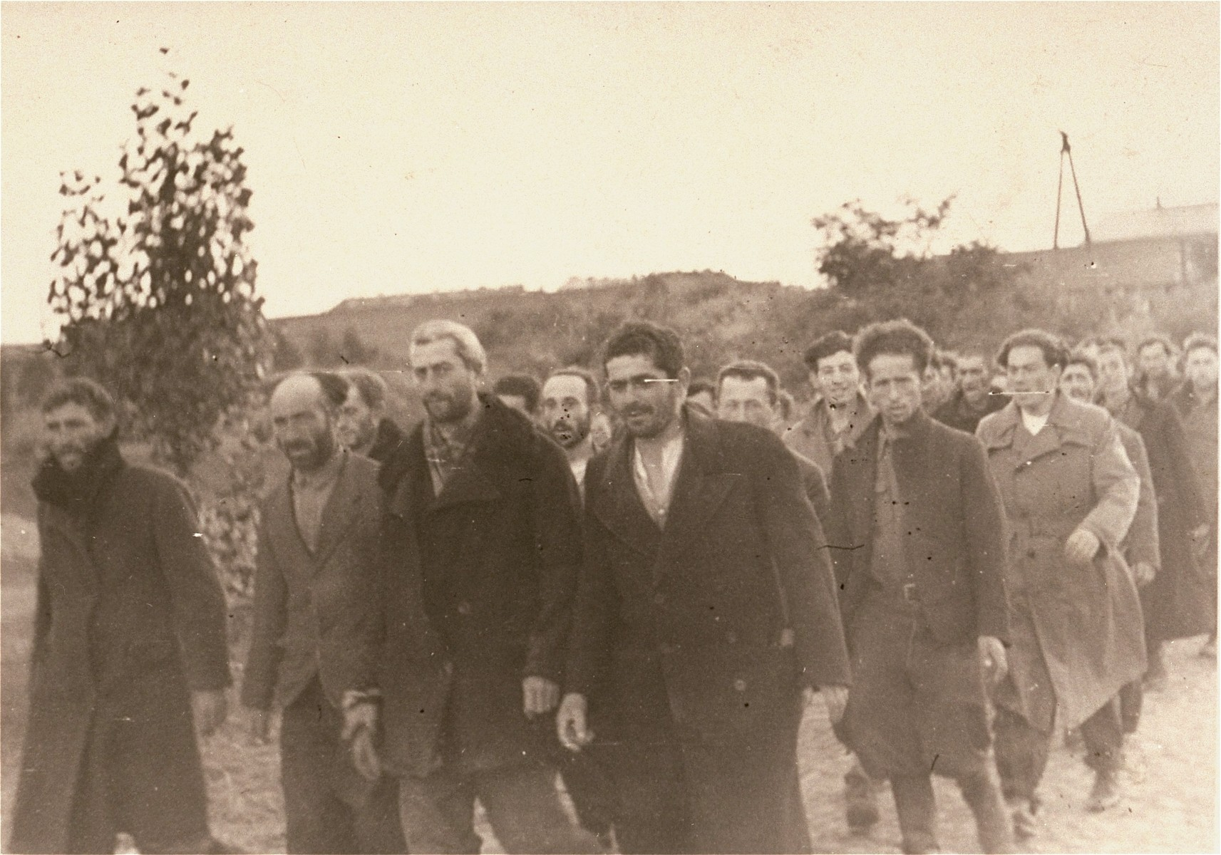 "[Probably, Poles and Jews who have been rounded-up by the SD marching to a temporary internment center.]  These prisoners may be what the Germans referred to as ""Wehrfaehige,"" or persons capable of carrying arms, who were summarily interned during and immediately after the Polish campaign as a security measure.   One of twenty-six images of Einsatzgruppen activities in Poland in 1939, found by Joseph Igra after the war, in a an album in an apartment in Sosnowiec."