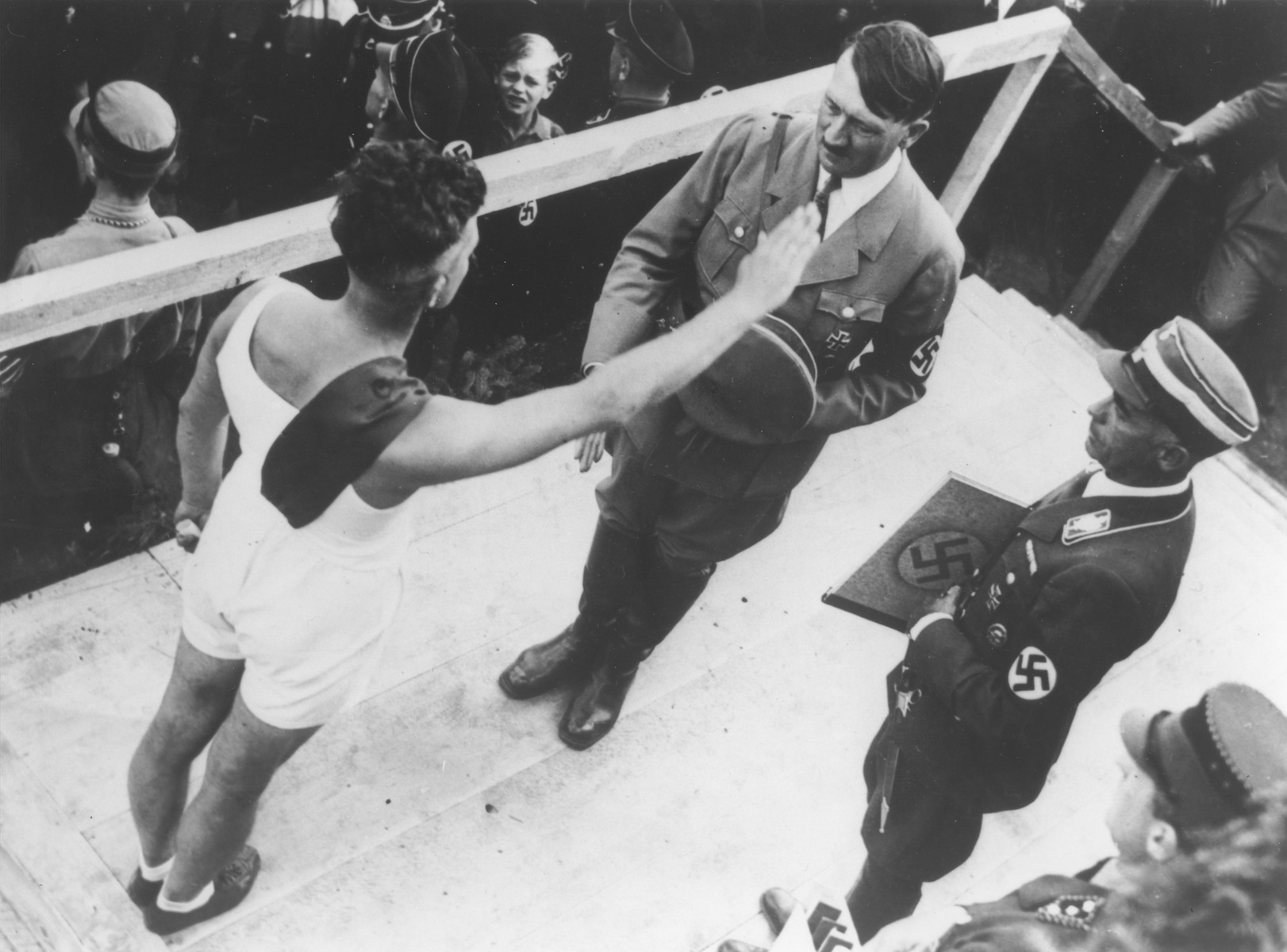 An athlete salutes Hitler at a ceremony to demonstrate loyaty to the Saar district at the Ehrenbreitstein fortress in Koblenz.     Reich sports leader Hans von Tschammer und Osten (right) is about to present the athlete's message of loyalty to Hitler.