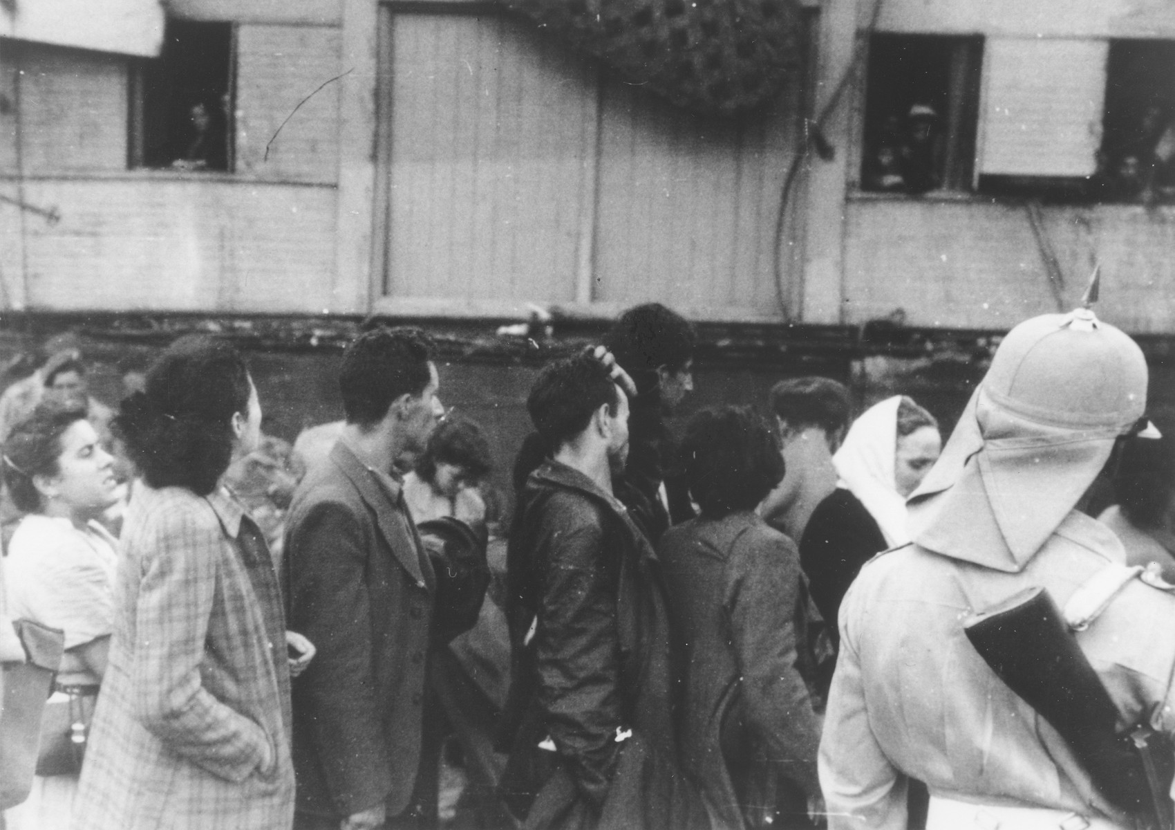 Passengers from the illegal immigrant ship, Exodus 1947, wait in line on the pier in Haifa to have their papers checked, before being transferred to British ships that will return them to Europe.