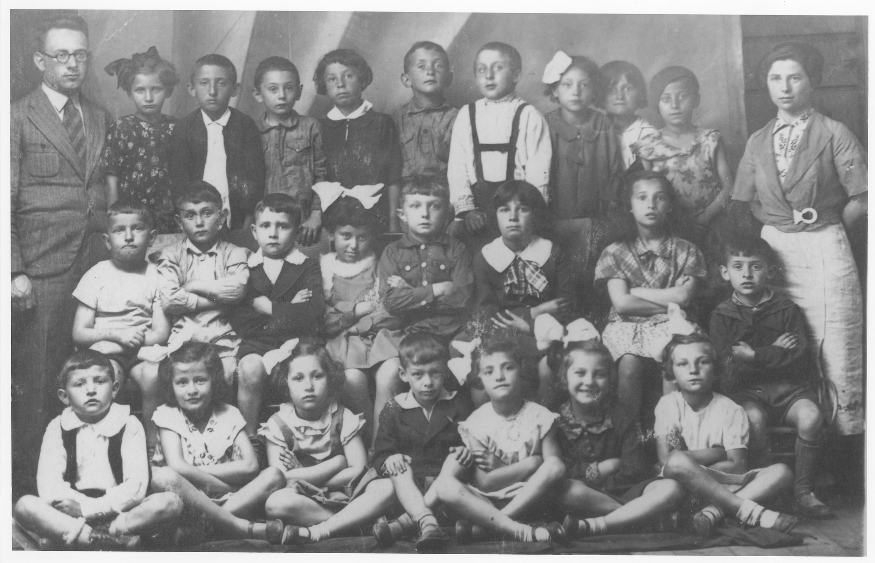 Group portrait of Jewish children in the first grade at the Tarbut school in Ostrow Mazowiecka.  Among those pictured are: Shmuel Povilewitch (top row, fourth child from the right); H. Podvilewitch (middle row, third from the left); Ruth Zlatkowska (front row, second from the left); Shimon Epstein (front row, center); Aaron Rubinstein (middle row, first on the right).