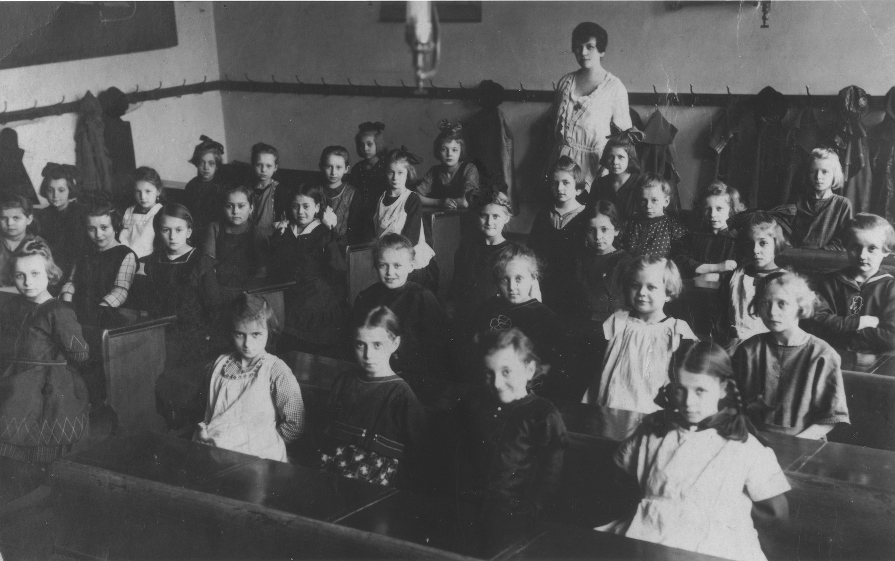 Pupils pose with their teacher in a classroom at an elementary school in Prague.  Among those pictured are Marta Mautnerova (third row from the front, at the far left).