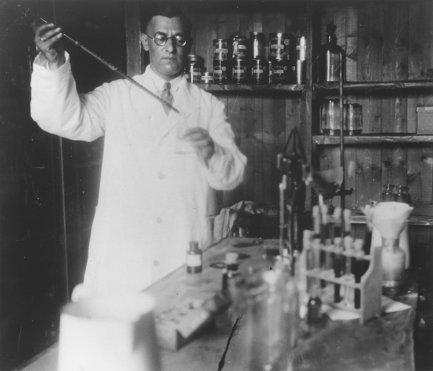 Cecil Gelbart at work in his chemistry laboratory in Hamburg, Germany.