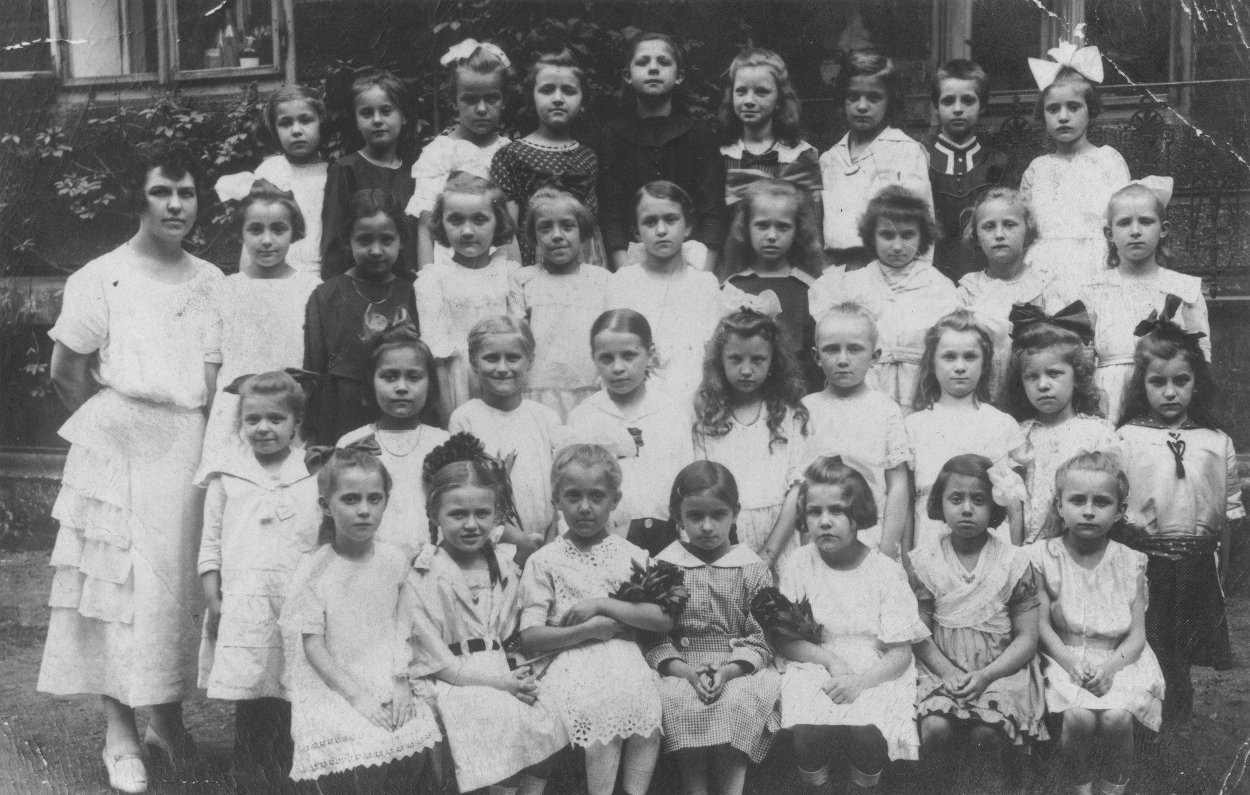 Class portrait of pupils at an elementary school in Prague.  Among those pictured is Marta Mautnerova (third row from the front, first child on the left); Lotty Voticka (front row, second from the right), who survived Theresienstadt with Marta; and Ludmilla Smolkova (third row from the front, second from the left), who survived the war in Shanghai.