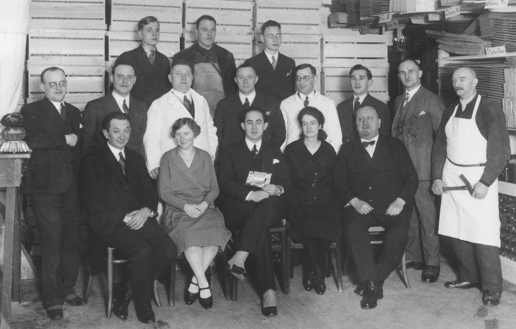 Group portrait of the employees of a business where Cecil Gelbart worked as a chemist.  Cecil Gelbart is standing in the middle row, fourth from the right.