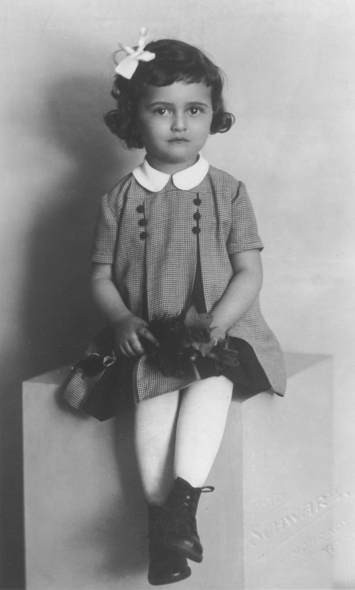Studio portrait of a young Jewish girl shortly before her deportation from Prague.  Pictured is Eva Nemova (b. 1937), the niece of Marta (Mautnerova) Pekova.  Eva later perished in Theresienstadt or Auschwitz.