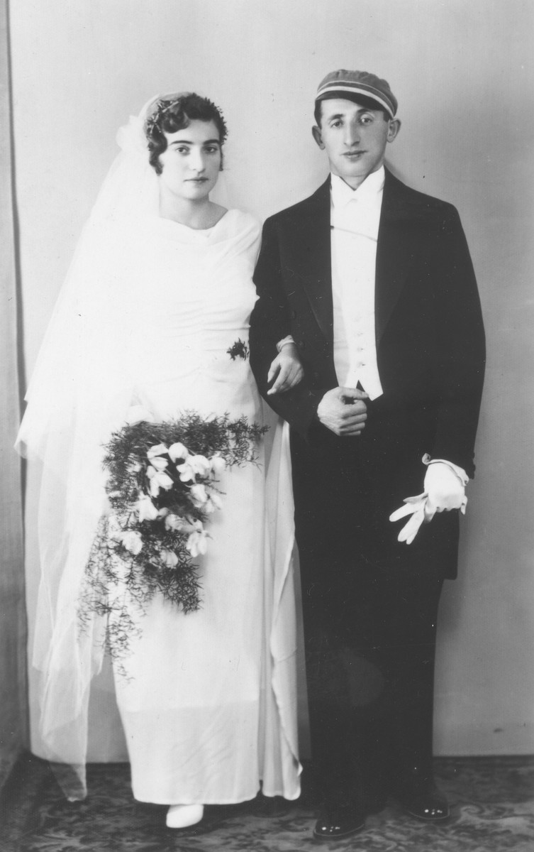 Wedding portrait of a young Jewish couple in Nazi Germany.  The groom is wearing the cap of his Jewish fencing club.